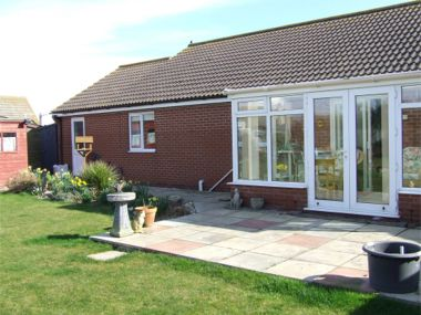 Rear garden with conservatory and patio